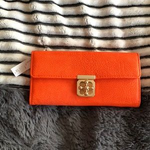 NWT Charming Charlie Orange Clutch Wallet